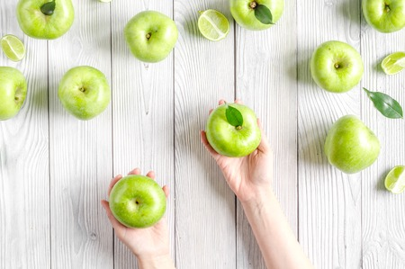 summer food with green apples on white background top view Stock Photo