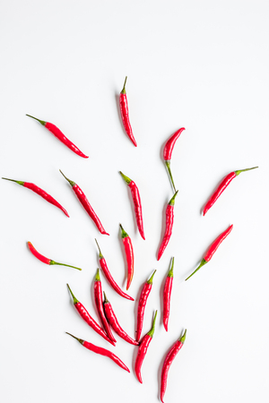 hot food with red chili pepper on white table background top view mock-up Stock Photo