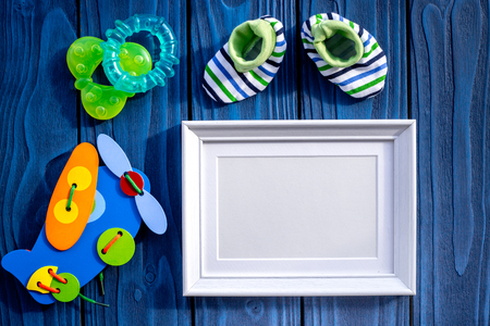 Presents Set For Baby Shower With Frame On Blue Wooden Background