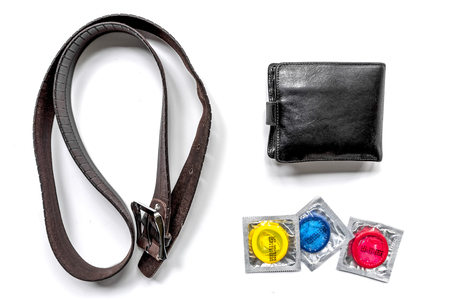 male contraception for safe sex with condoms and wallet on white desk background top view Stock Photo