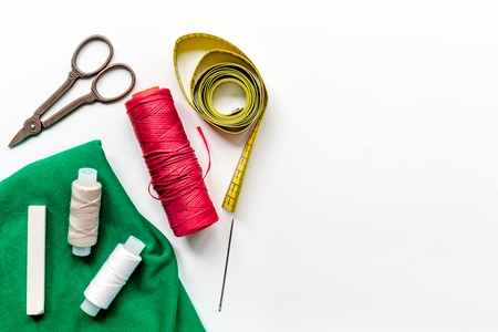 sewing hobby with tools, thread, scissors white background top view space for text Stock Photo