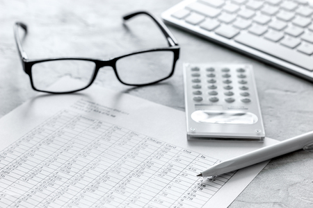 keyboard: business accounter work with taxes and calculator on white office desk background