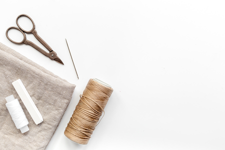 Sewing tools, fabric and kit for hobby collection on white background top view mock-up