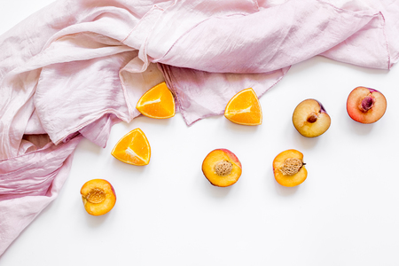 cut peach and orange for exotic fruit on white background top view Stock Photo