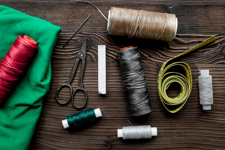 Tools for sewing and handmade for hobby set wooden desk background top view Stock Photo - 78823070