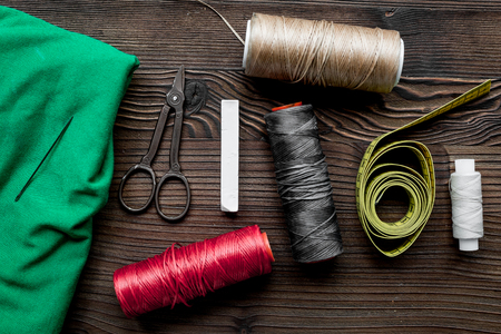 kit de costura: Sewing tools and kit for hobby collection on wooden background top view