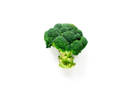 breackfast: green fresh broccoli for fitness diet food on white table background top view Stock Photo