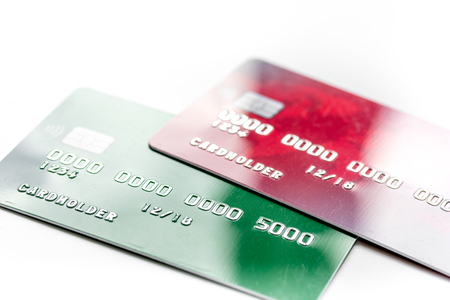 work place with business credit cards for payment on white office desk background close up