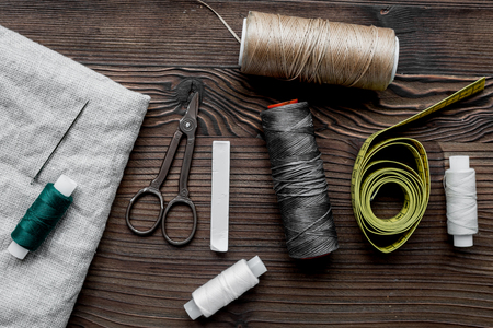 sewing hobby with tools, thread, scissors wooden background top view Stock Photo