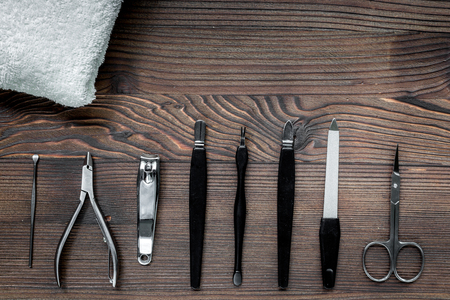 manicure and hands care set with nippers, cuticle scissors on wooden table background top view Stock Photo
