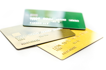 business with credit cards for payment on office desk white background close up