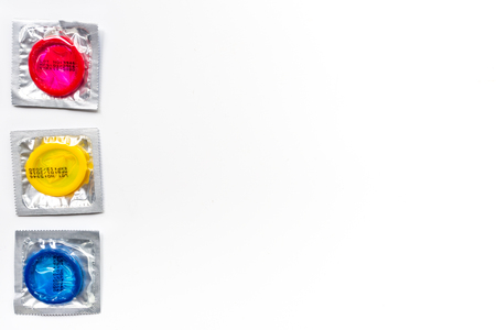 Condoms in package for safe sex on white background top view mock-up Stock Photo
