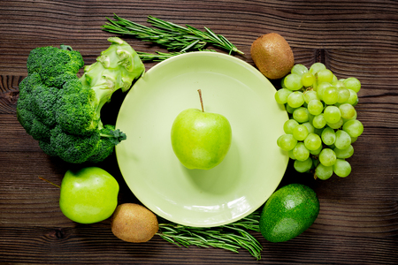 breackfast: organic food for homemade salad with green vegetables on wooden desk background top view