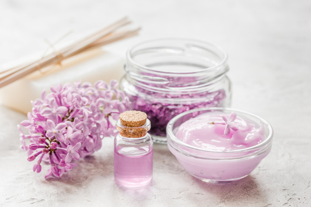 lilac natural cosmetic set for spa with salt stone table background Stock Photo