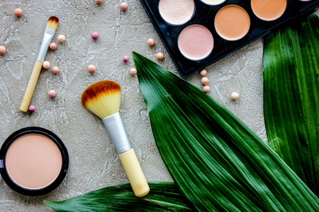 Beauty and fashion with decorative cosmetics for make up on stone woman table background top view pattern Stock Photo