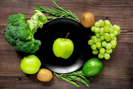 breackfast: healthy food with green vegetables, fruits for dinner on rustic table background top view