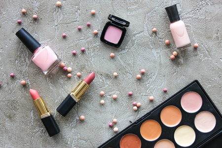 Tools for make up and cosmetics with pallet on gray stone table background top view pattern