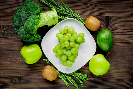 breackfast: healthy food with green vegetables, fruits for fitness dinner on rustic table background top view Stock Photo