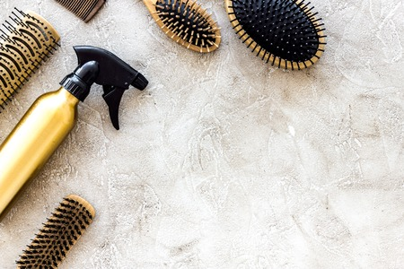 Combs and hairdress tools on stone table background top view copyspace. Stock Photo