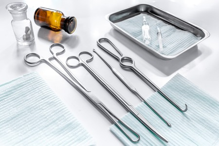 Medical instruments for plastic surgery on white backgrond top view copyspace. Stock Photo