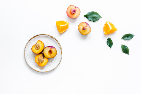 breackfast: woman summer breackfast with orange and peach fruits on plates on white desk background flat lay mockup