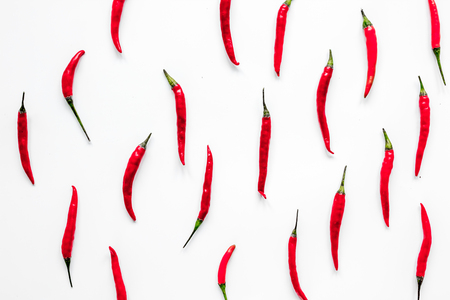 hot food with red chili pepper on white table background top view pattern Stock Photo