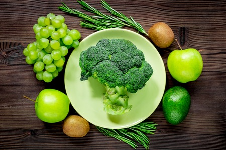 breackfast: green fresh food for fitness diet on wooden table  top view