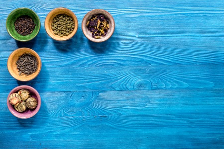 teaparty: Drink herbal tea with brew on blue wooden table  top view space for text Stock Photo