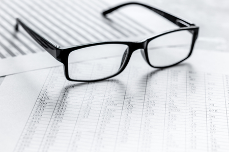 Business accounter work with taxes and glasses on white office desk background
