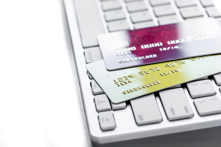 business with credit cards for payment on keyboard on office desk white background close up