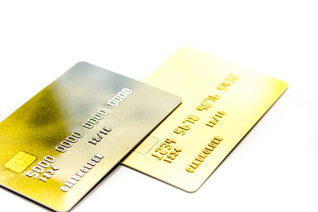 creditcards voor zakelijke betalingen op witte office bureau achtergrond close-up Stockfoto