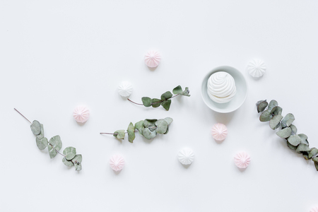 woman lunch with marsh-mallow and flowers soft light on white table background flat lay Stock Photo