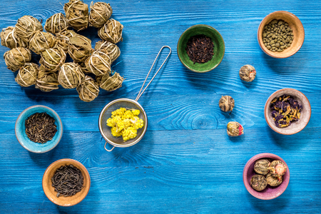 teaparty: Tea-party with different herbal tea on blue desk background flat lay mock up Stock Photo