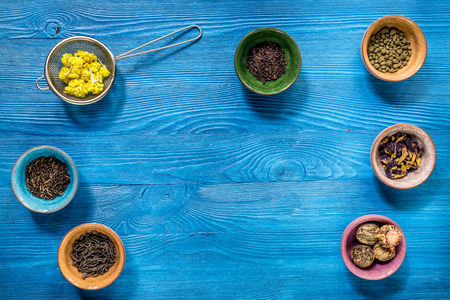 teaparty: Different kinds of herbal tea on blue background top view mockup Stock Photo