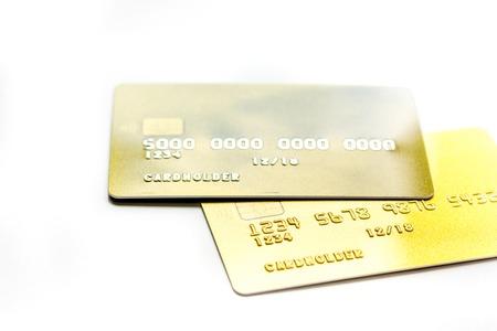 werkplaats met zakelijke creditcards voor betaling op witte bureau achtergrond close-up