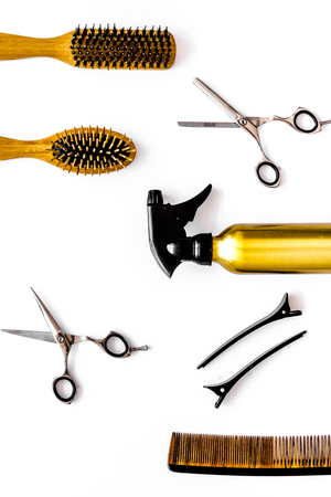 Professional hairdresser equipment on white background top view vertical.