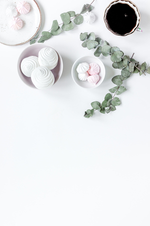 Sweet marsh-mallow and spring flowers on woman white desk background top view mock up Stock Photo