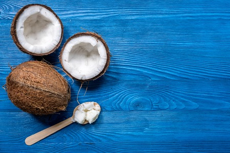 fresh coconut food and wooden spoon on blue table background top view mockup