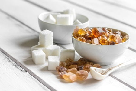 white and brown sugar for cooking sweets on kitchen white wooden table background top view close up Stock Photo - 80237908