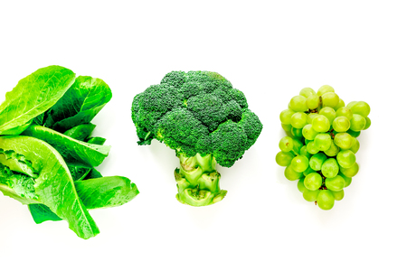 organic food for homemade salad with green broccoli on white kitchen desk background top view