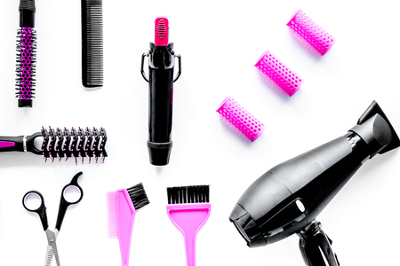 Hairdressing tools compositoin on white background top view.