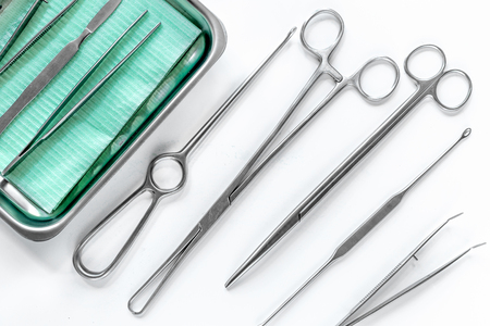 surgical instruments and tools including scalpels, forceps and tweezers on white table top view. Archivio Fotografico