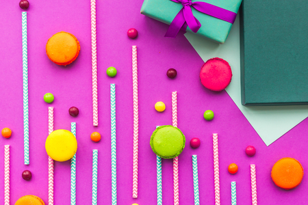 Birthday greeting cards, wrapped gifts and sweets on fuchsia background top view. Stock Photo