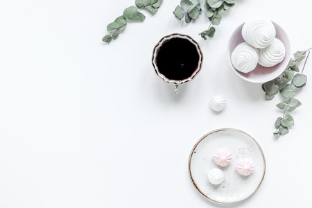 woman desk with plant, coffee and marsh-mallow in spring breakfast desing on white background flat lay mock-up Zdjęcie Seryjne