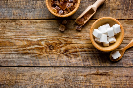 sugar cubes in bowls on kitchen stone table background top view mockup