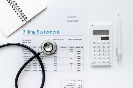 health care billing statement with doctors stethoscope on white table background top view mock-up