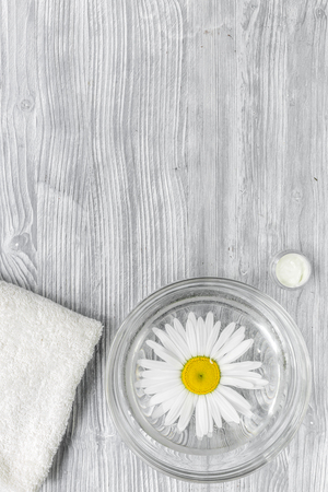 Spa composition on wooden desk with chamomile and towel copyspase top view vertical Stock Photo