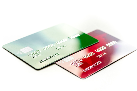 Payment composition with business credit cards at work place white background close up