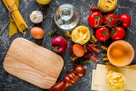 Italian food concept pasta ingredients on grey stone desk background top view mock up Stock Photo