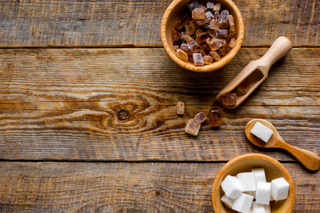 cooking sweets set with different sugar lumps on kitchen rustic table background top view mockup